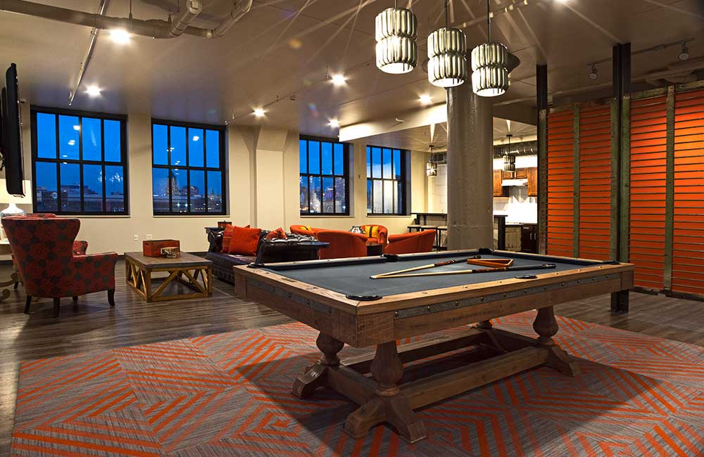 Clubroom with couches and pool table