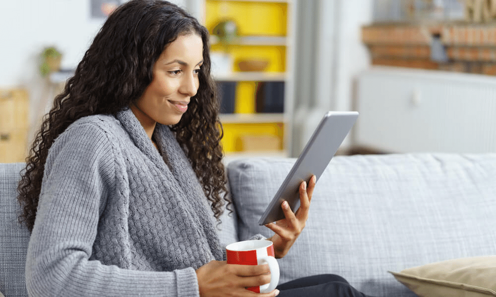 Woman holding tablet and coffee