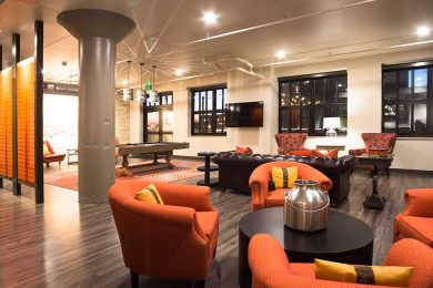 Clubroom with red orange furniture