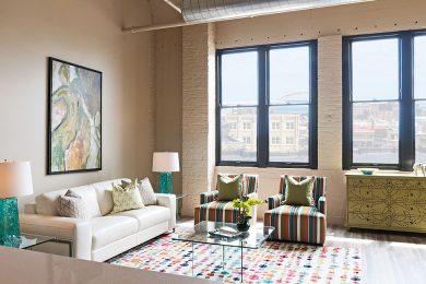 One Bedroom Model - Open Concept Living Area With Bank Of Oversized Historic Windows