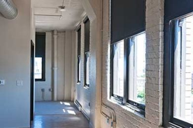 One Bedroom Unit - Bank Of Oversized Historic Windows With Room Darkening Shades