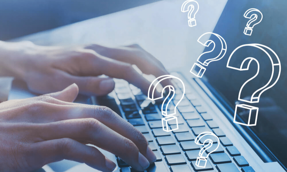 Woman typing on laptop with questions